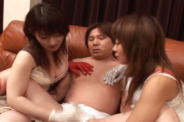 Porn Tube of Two Hot Asians Try Out Different Gloves To Jack A Guy Off