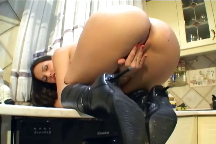 Sex Movie of Busty Chick With Leather Boots Masturbates In The Kitchen