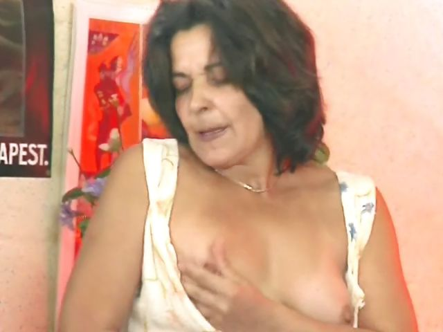 Porn Tube of Mature German Hoochie Fucks Her Dark Hairy Cooch With A Toy