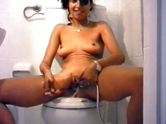 Porno Video of Tanned German Teen Shaves Her Chocolate Pussy On The Toilet