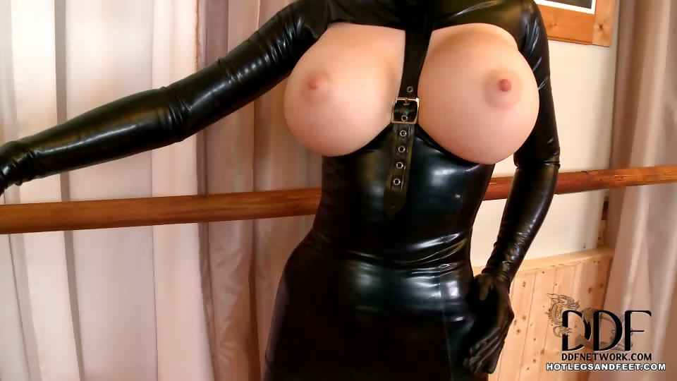 Porno Video of Happy Kinky New Year And Welcome To Madame Latex Lucy's Bizarre Ballet Studio, Where All Her Novice Dancers Must Be Fully Attired In Latex Just As She Is! The Ballet Mistress Stands In Her Black Latex Dress, Beige Latex Leggings, And Red Ballet Heels As S