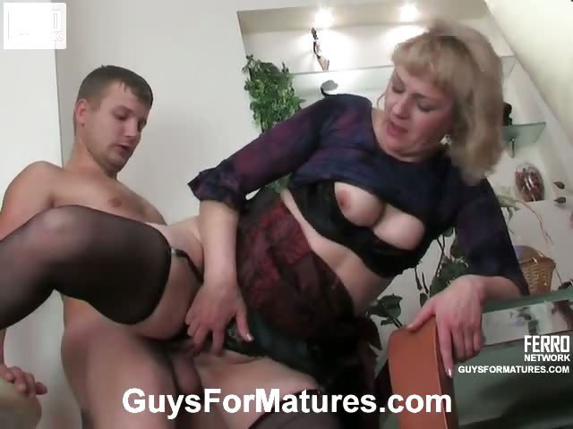 Porno Video of Dressed To Kill Blonde Oldie Getting Groped And Banged From Behind By A Guy