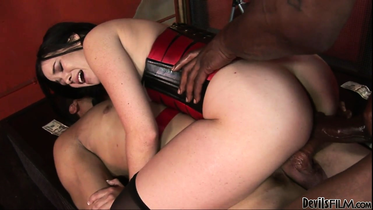 Porno Video of Brunette Babe In A Sexy Red Corset Gets Pinned By Two Big Cocks