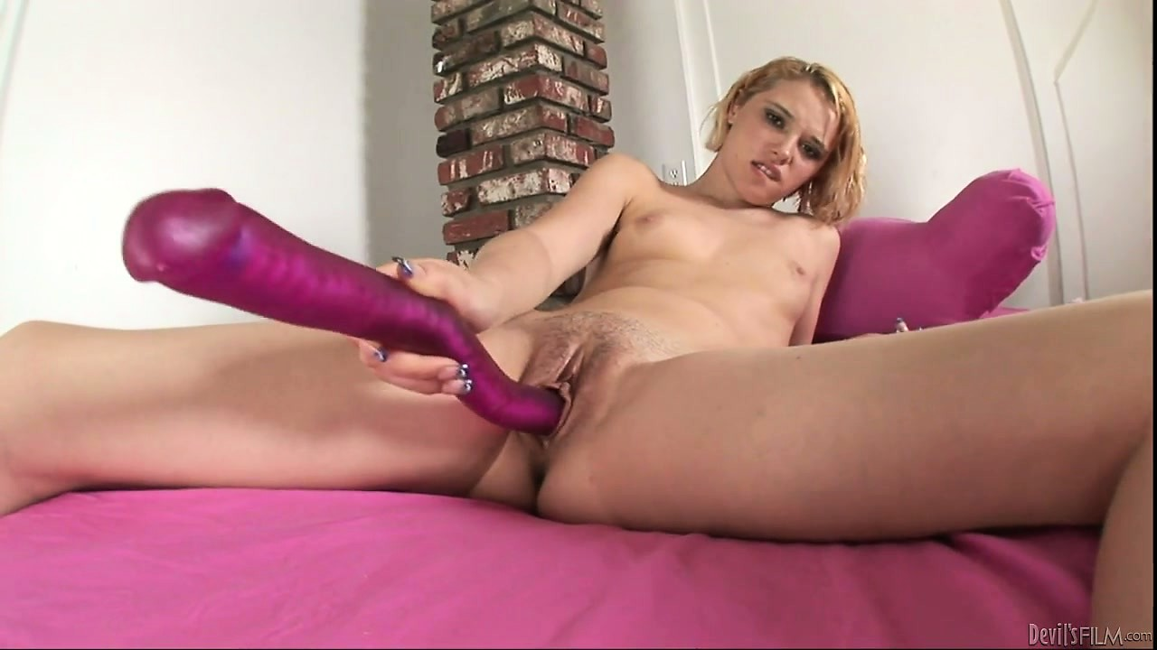 Porno Video of She Uses A Huge Purple Dildo To Stick Into Her Wet, Hungry Puss