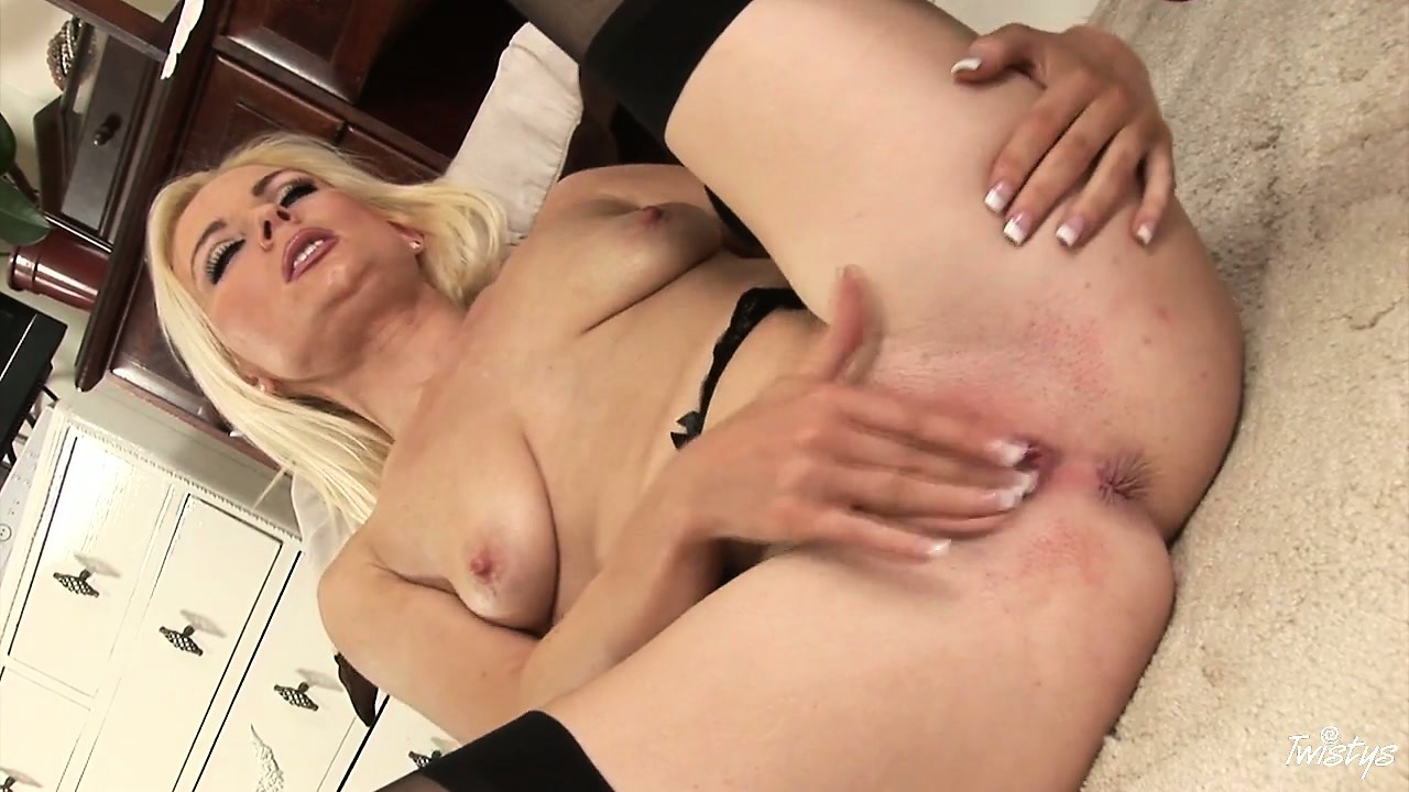 Porno Video of Hot Looking Blonde In Black Nylons Fingers Her Pink Slit For Pleasure