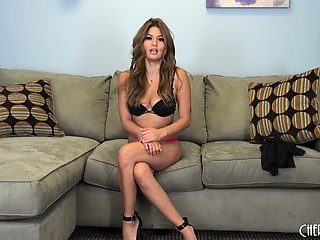 attractive charmane star sits on the sofa sharing her sexual fantasies and desires
