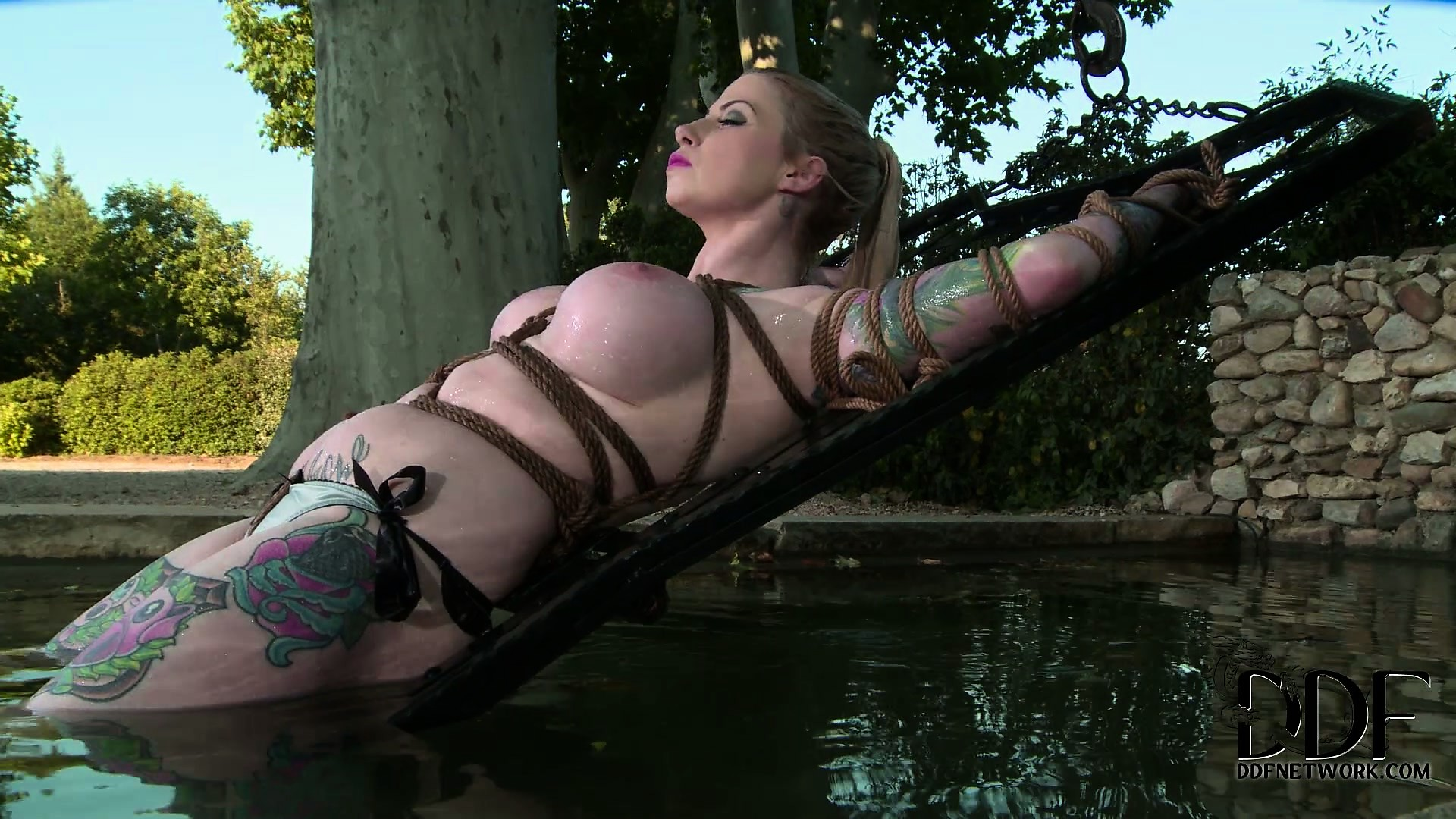 Porn Tube of Inked Up Blonde Chick Gets Tied Up And Dipped In The Cool Water