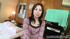 Sultry Asian milf seductively reveals the hot body she hides underneath her clothes