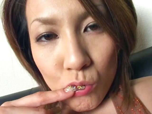 Porn Tube of A Smoking Hot Japanese Cougar Teases With Her Feet And Pussy