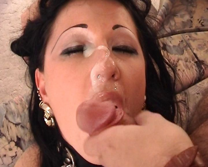 Porno Video of A Big And Messy Portion Of Cum Oozing Out Of Hard Cock Straight On Chick's Nose