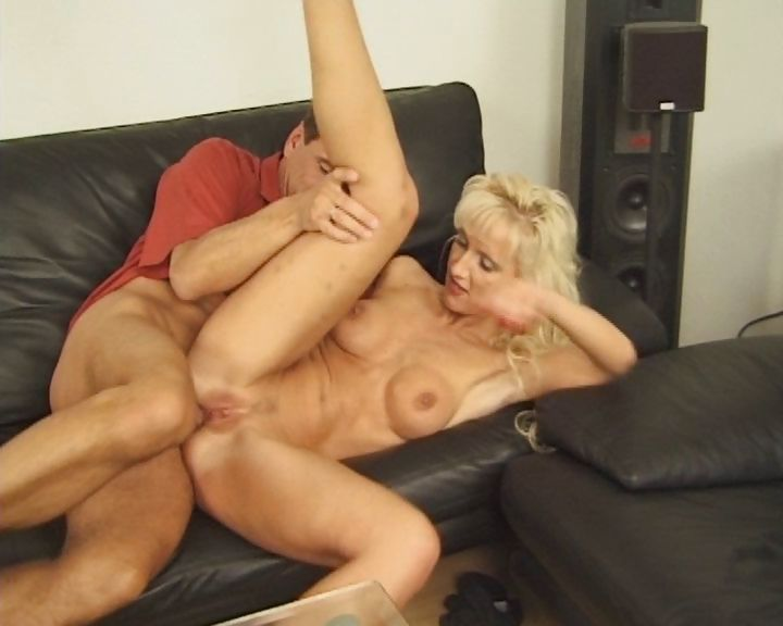 Porno Video of Bony Cougar Bends Over A Glass Table To Take It Doggy Style